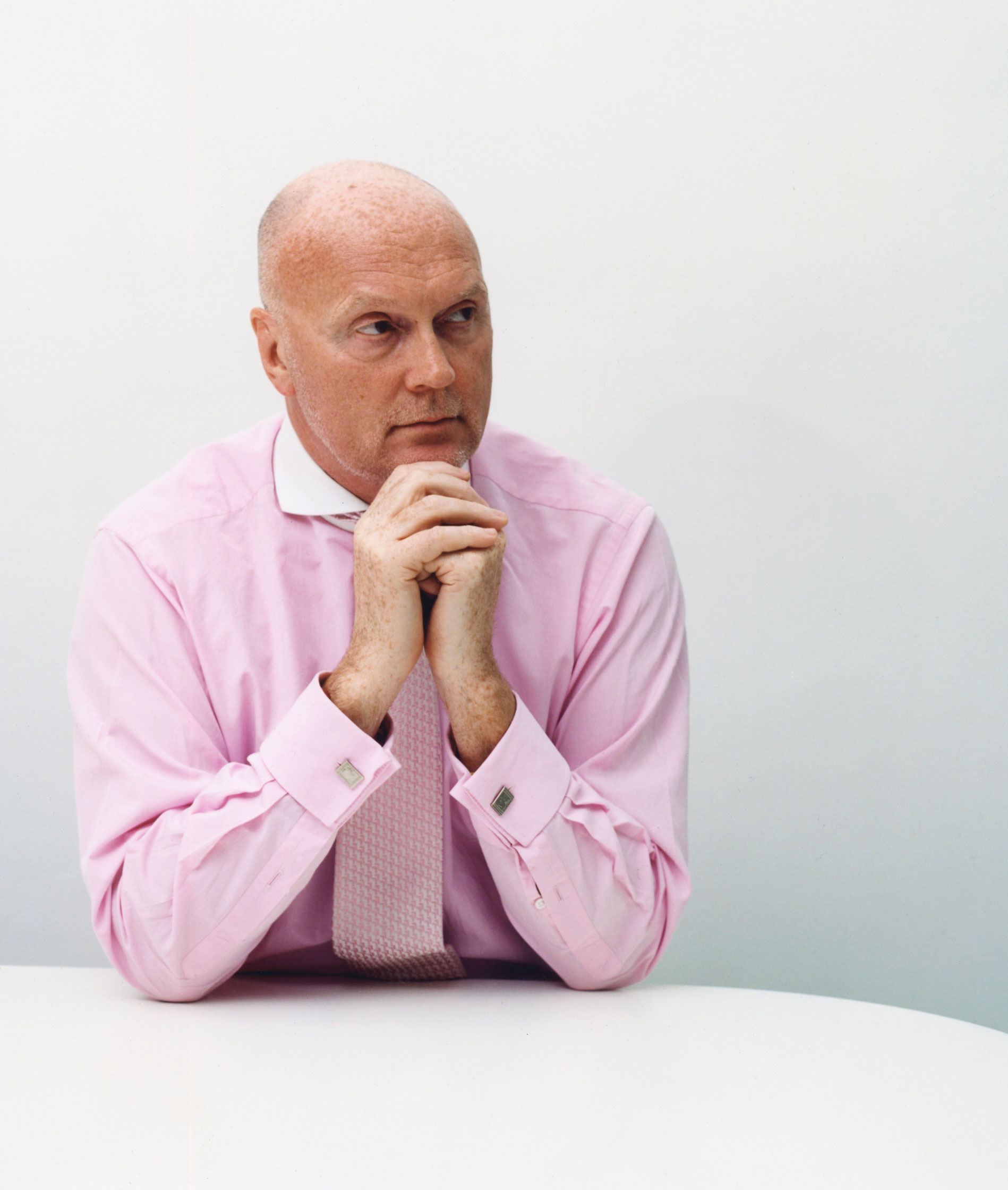 Allan Leighton in pink shirt