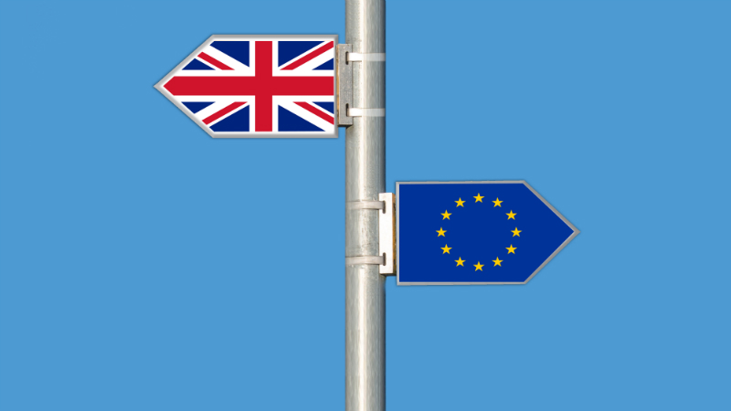 Brexit sign post depicting the union jack in the opposite direction to the EU flag