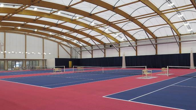 2 indoor tennis courts under large domed roof