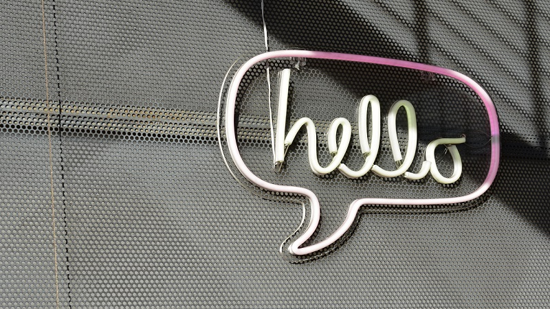 A wall with an LED hello sign