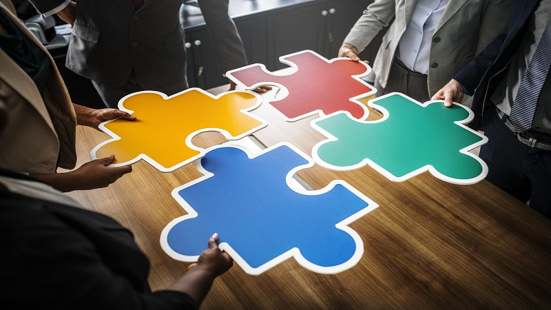 People assembling a giant jigsaw