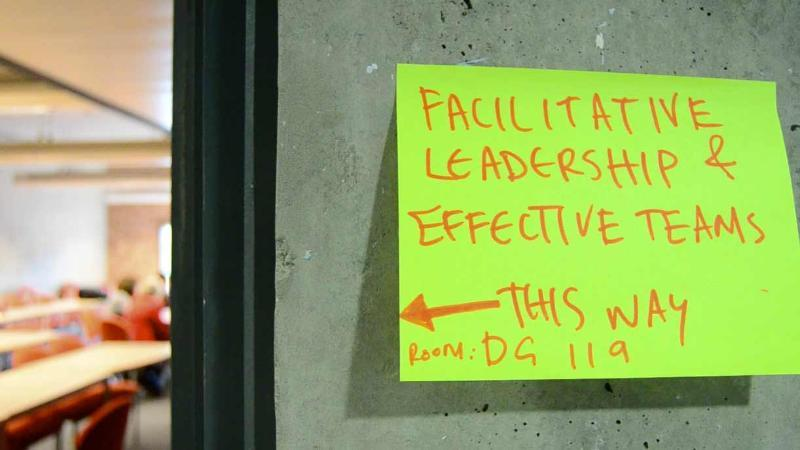 Sign pointing to facilitative leadership workshop