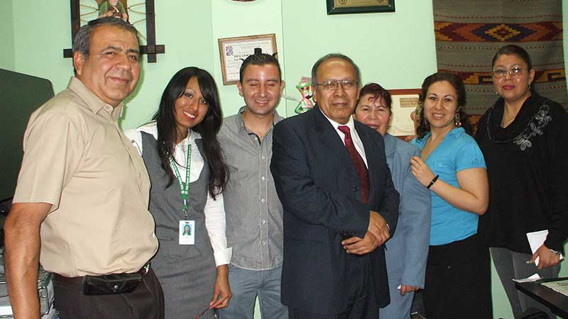 Member of cooperative bank Jesus meza Sanchez standing in a group
