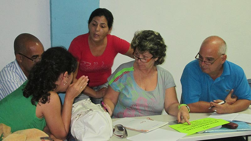 Multisectorial staff working around table in Cuba