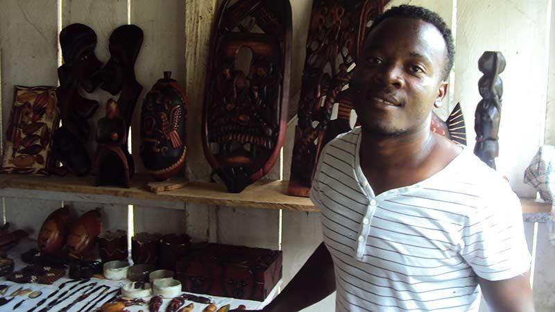 Man selling traditional artefacts, Guinea Bissau