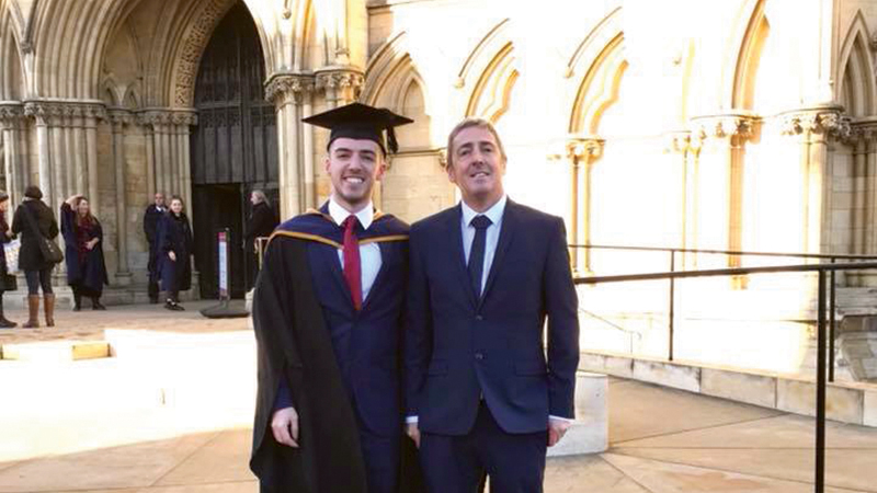 Photo of George and his Dad at graduation